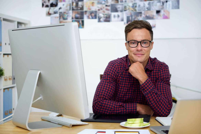 Smiling handsome web designer